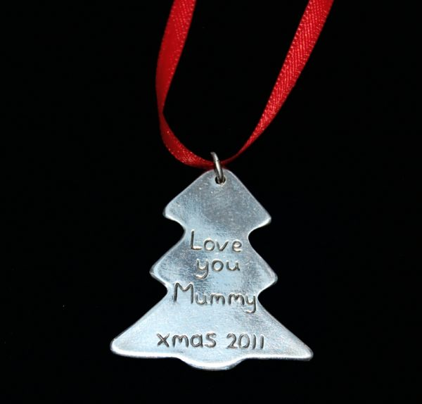 Personalised message on the back of a silver Christmas tree fingerprint charm.