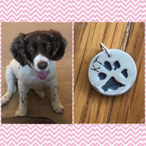 KT and her paw print charm