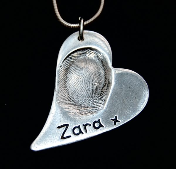 Large curved heart silver fingerprint charm with one large print and name alongside.