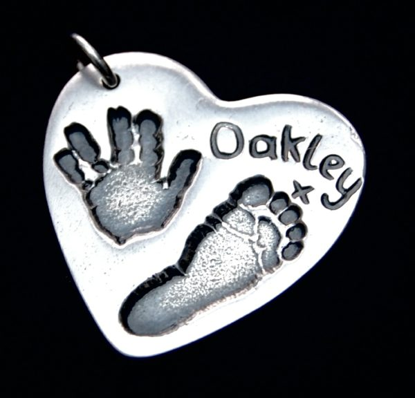 Large silver heart charm with hand & footprint and hand inscribed name.