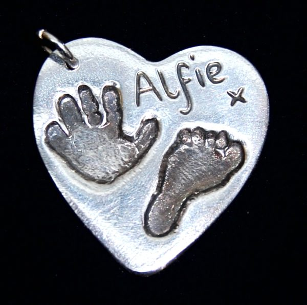 Large silver heart charm with hand & footprint and name hand inscribed alongside the prints.