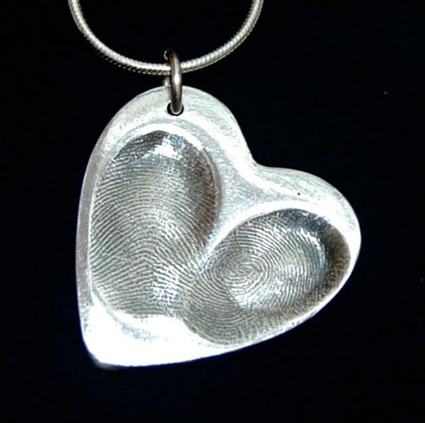 Large heart shaped silver fingerprint charm with 2 fingerprints side by side. Names hand inscribed on the back.