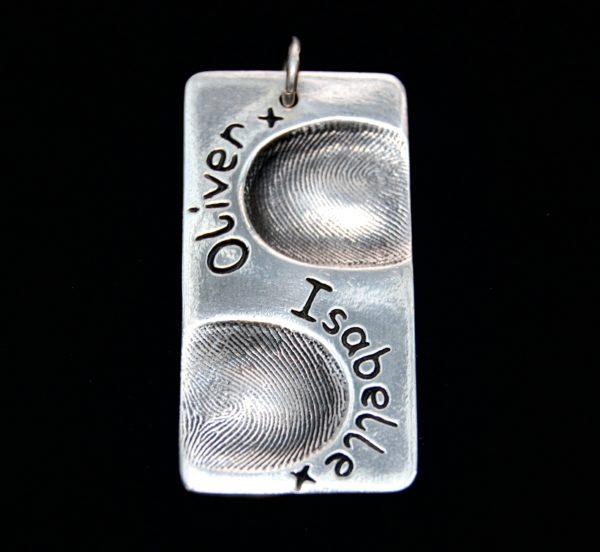 Large rectangle shaped silver fingerprint charm, showcasing 2 fingerprints and names on the front.