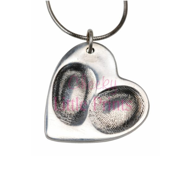 Large silver heart with fingerprints