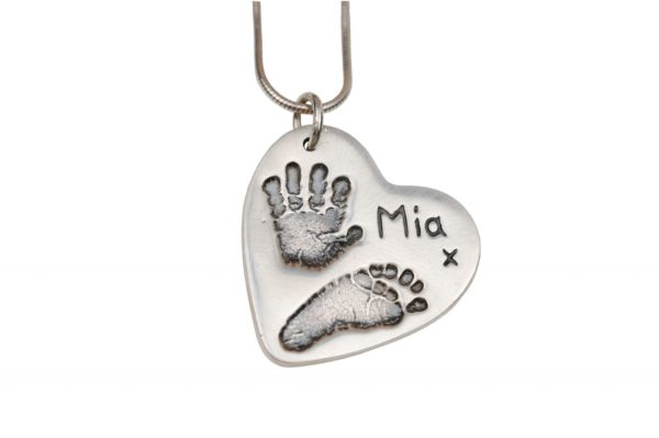 Large silver hand and footprint charm
