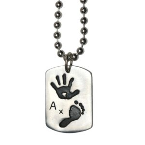 Large silver dog tag with hand and footprint on a silver ball chain