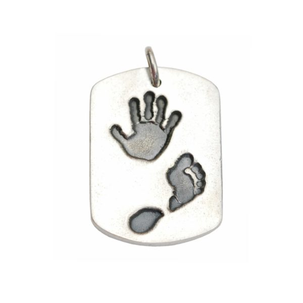 Large silver dog tag with hand and footprint