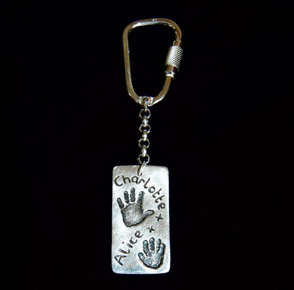 Large silver rectangle handprint keyring.