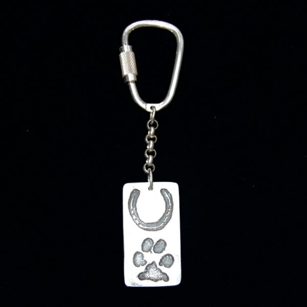 Large silver rectangle charm with horse shoe imprint and paw print. Pet names are hand inscribed on the back.