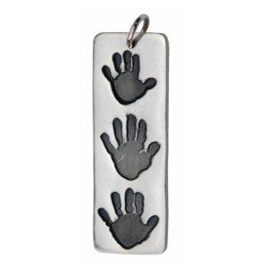 Long silver rectangle charm showcasing three handprints