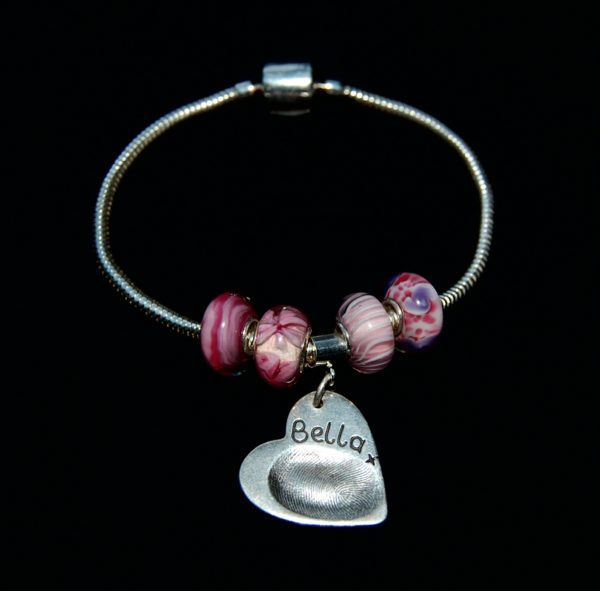 Regular heart shaped silver fingerprint charm with charm carrier. Bracelet can be purchased separately from the Accessories section.