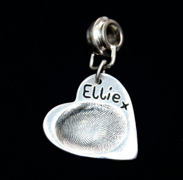 Regular heart shaped silver fingerprint charm presented on a charm carrier.