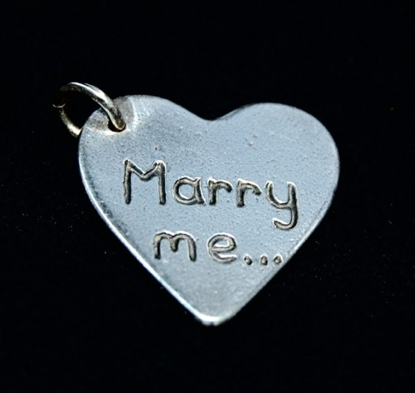 Regular silver heart charm inscribed with your special message.