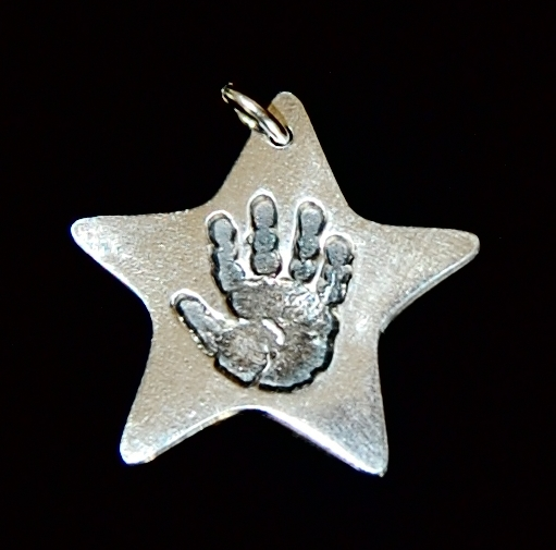 Regular silver star handprint charm with name inscribed on the back.