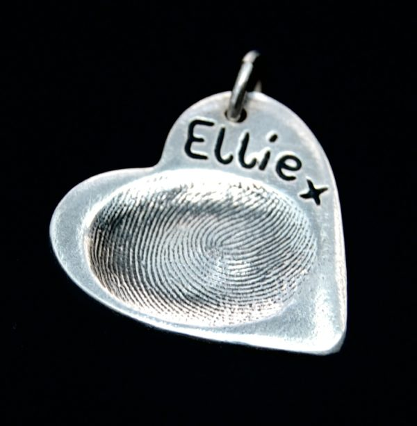 Regular heart shaped silver fingerprint charm with fingerprint and name inscribed on the front.