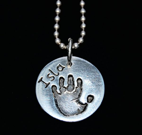 Regular silver handprint charm with name hand inscribed alongside the print. Silver ball chain can be purchased separately.