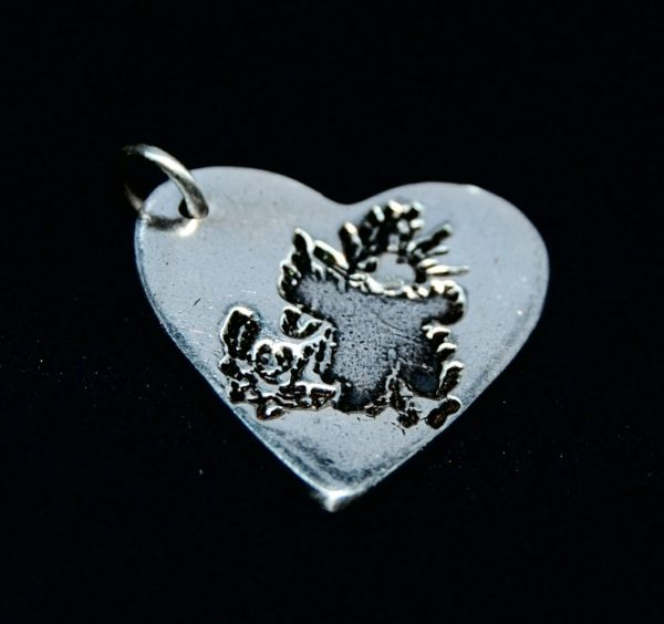 Regular silver heart charm showcasing your child's precious drawing.