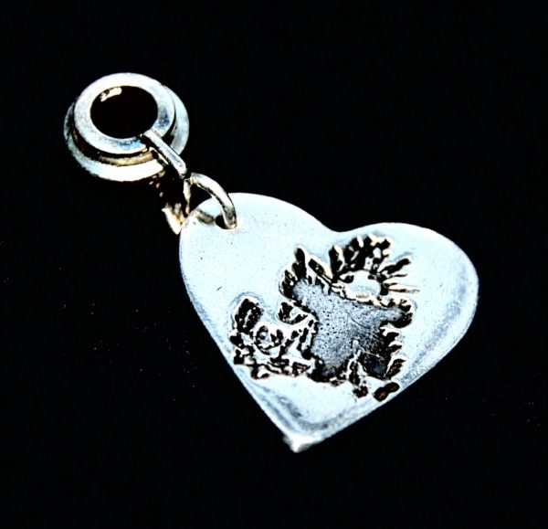Regular silver heart charm featuring your child's precious drawing or loved one's handwriting. Presented on a charm carrier ready to add to your bracelet.