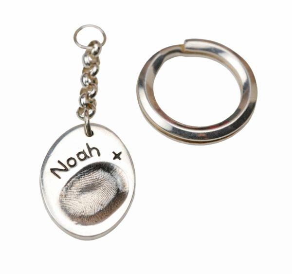 Silver oval fingerprint keyring