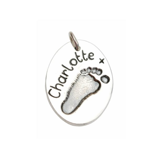 Silver oval charm with footprint