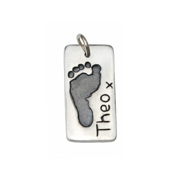 Silver rectangle charm with footprint