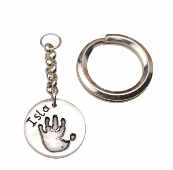 Silver circle keyring with handprint and name