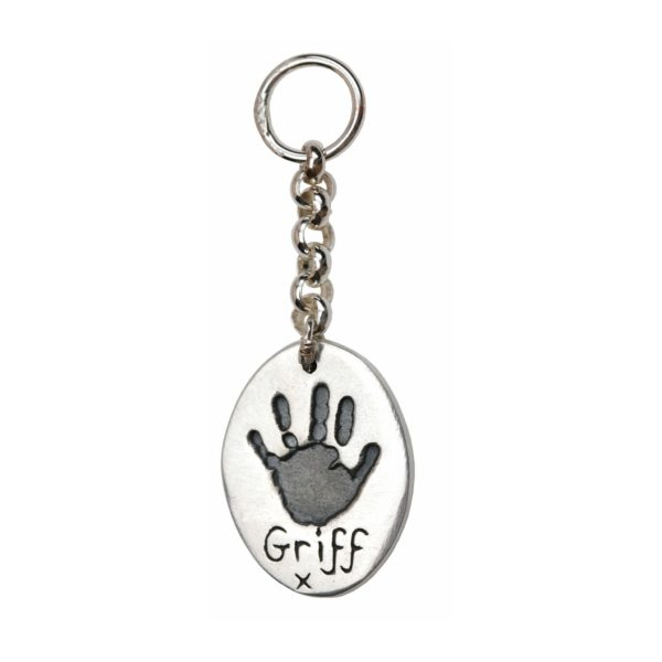 Silver oval keyring with handprint