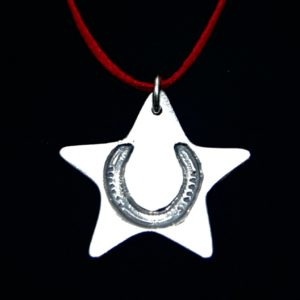 Silver star Christmas charm with your horse's unique shoe imprint. Presented on festive red ribbon ready to hang.