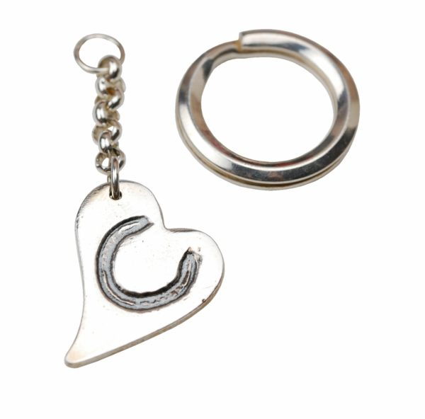 Silver curved heart keyring with horse shoe