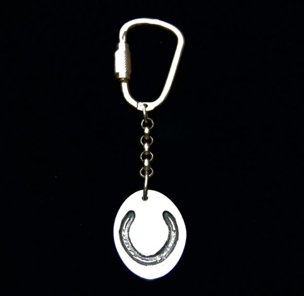 Regular silver oval keyring showcasing your horse's shoe imprint.