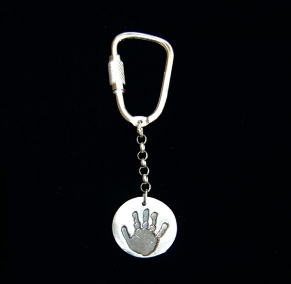 Regular silver circle handprint keyring with name inscribed on the back.