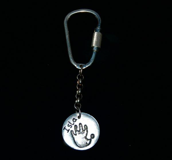 Regular silver circle keyring with handprint and name personalisation.