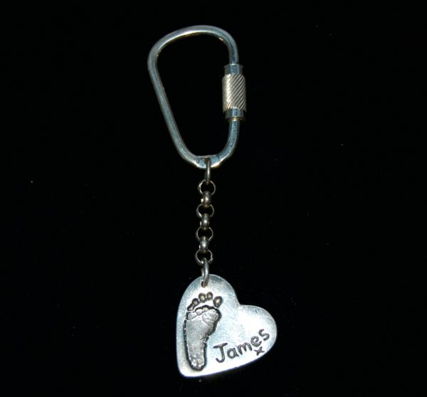 Regular silver heart keyring with footprint and name hand inscribed alongside the print.