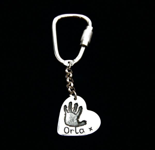 Regular silver heart handprint keyring with name hand inscribed.