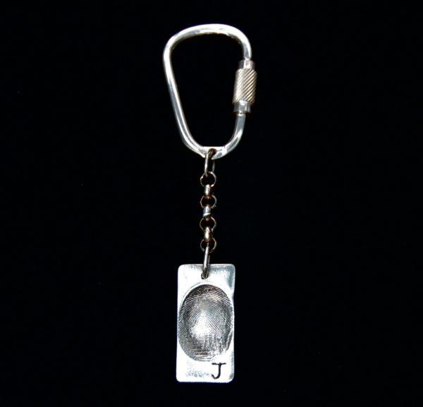 Regular rectangle shaped fingerprint keyring with sterling silver keyring attachment.