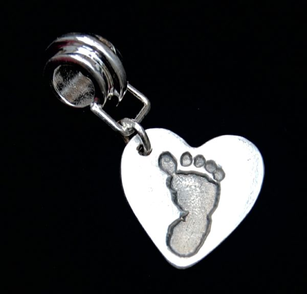 Small silver heart footprint charm with charm carrier.