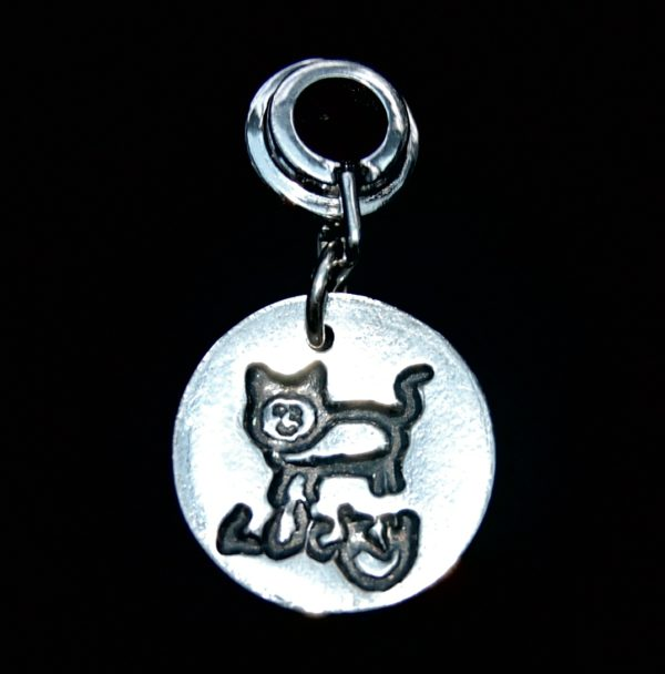 Small silver circle charm featuring your little one's first drawing and/or writing. Presented on a charm carrier ready to add to your bracelet.