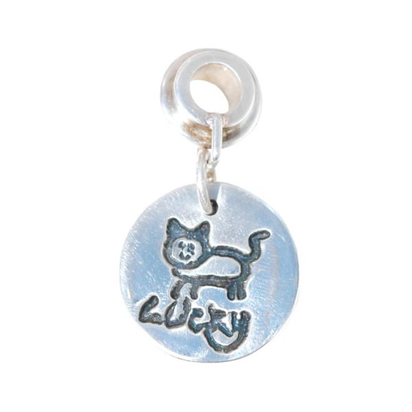 Small silver charm showcasing your child's drawing