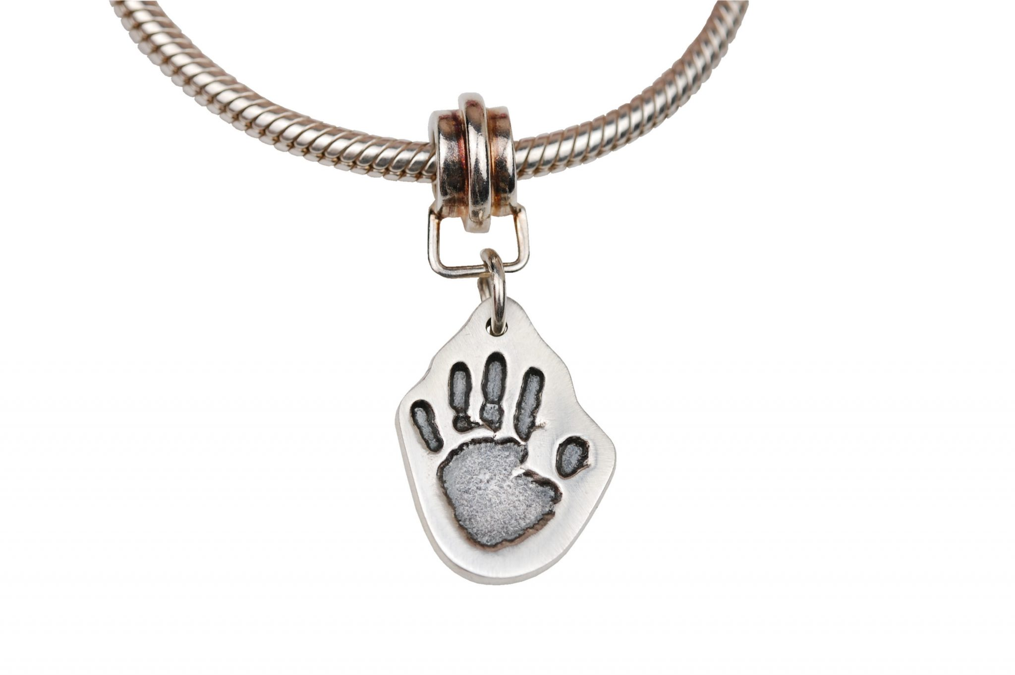 Small handprint cut out charm and charm carrier
