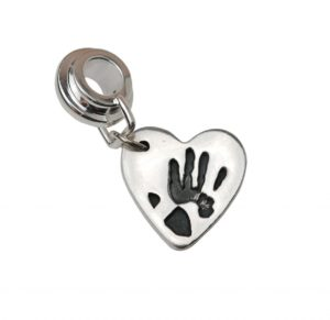 Small heart charm with charm carrier showcasing Gpas handprint