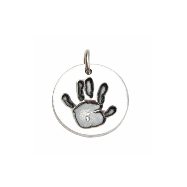 Silver circle charm with hand print