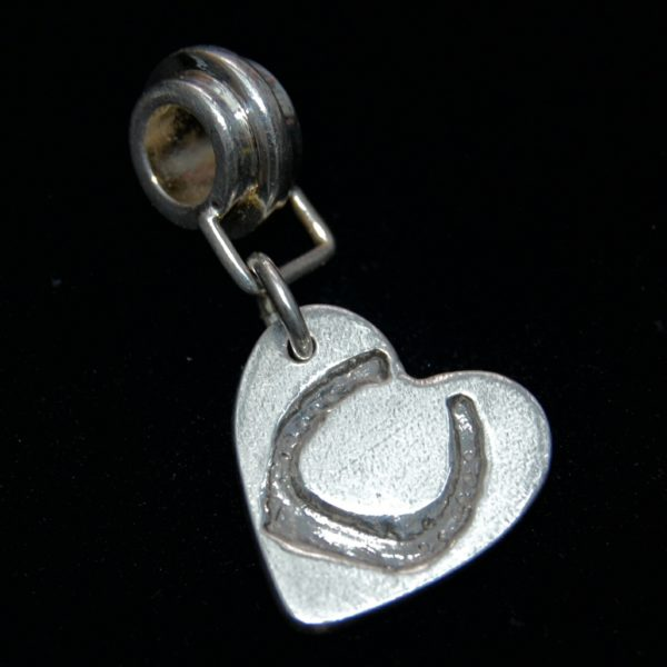 Small silver heart charm with your horse's shoe imprint. Presented on a charm carrier ready to add to your bracelet.