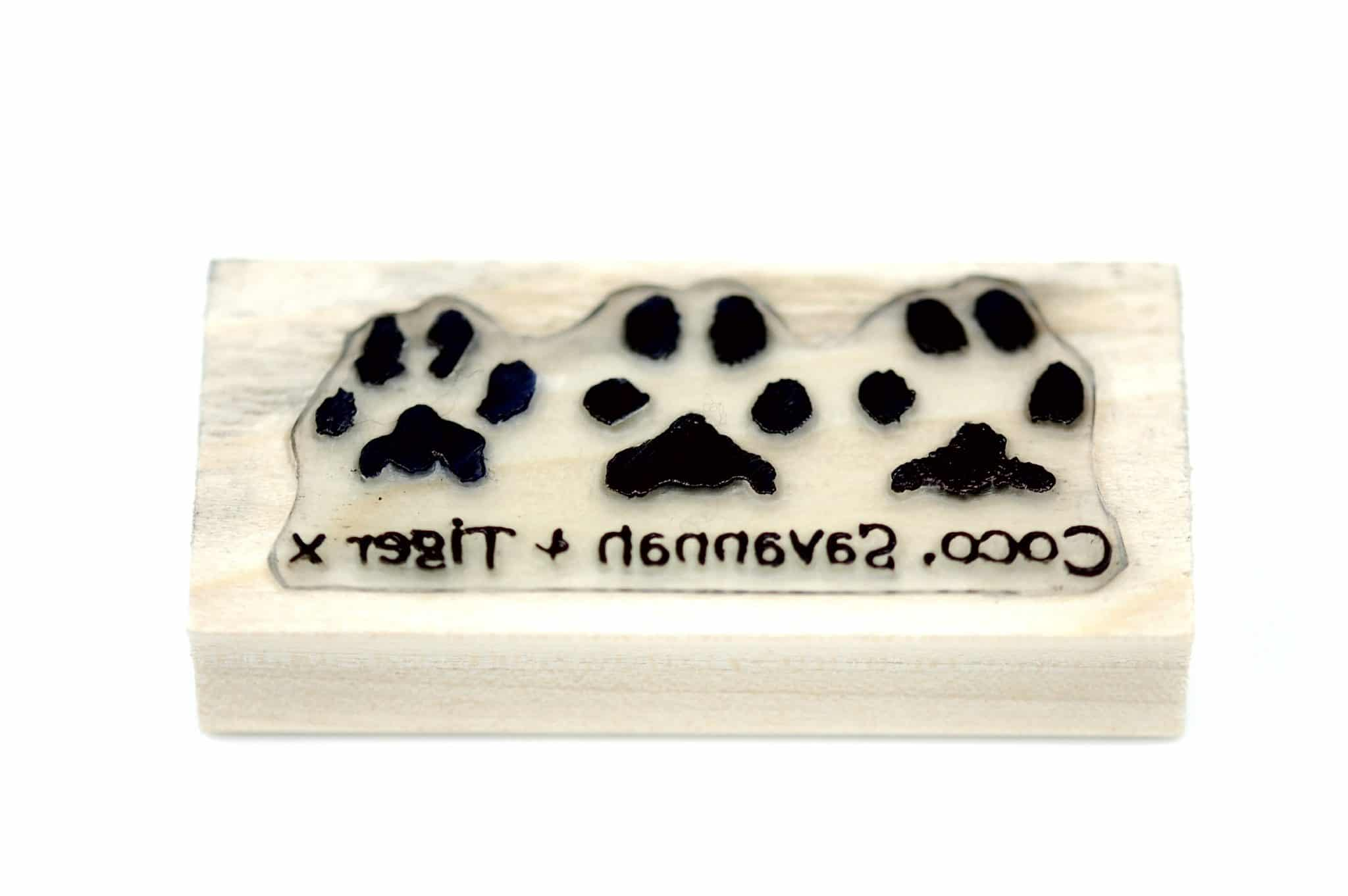 Personalised stamp showcasing 3 of your pet's paw prints