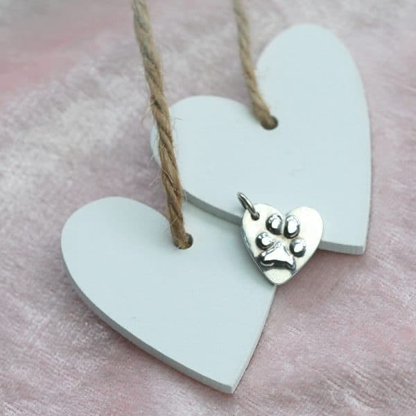 Small raised paw print heart charm