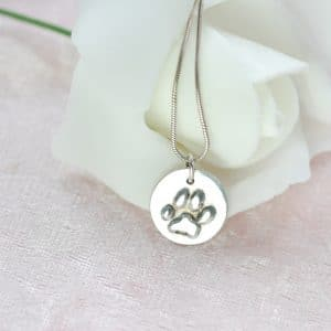Small riased paw print charm