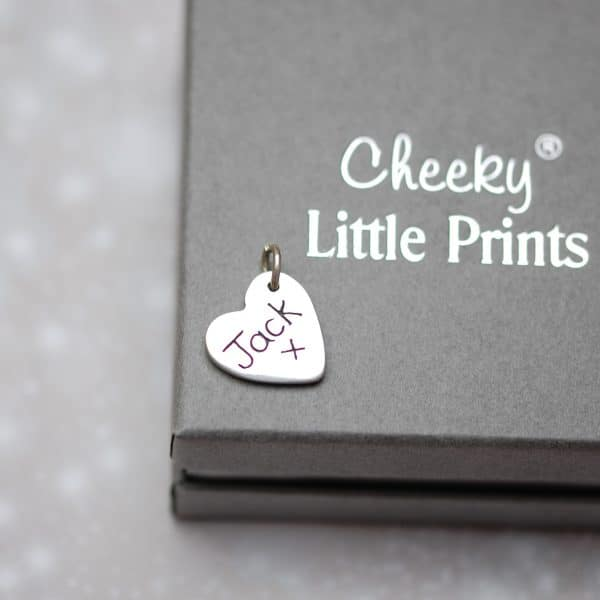 Inscription on the back of paw pad print charm