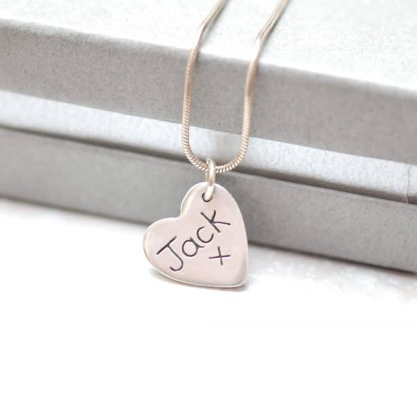 Inscription on the back of silver paw pad print charm