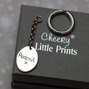 Inscription on back of paw pad keyring