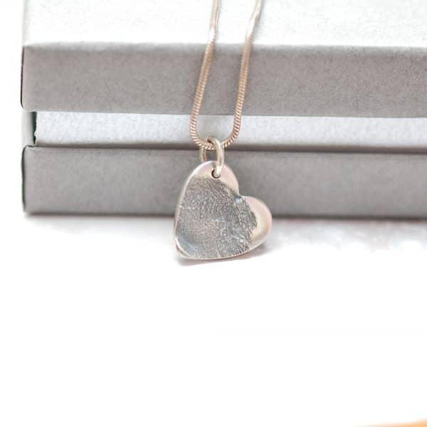 Small silver paw pad print charm