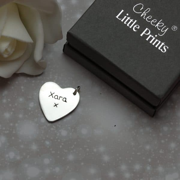 Inscription on the back of hold my paw forever charm
